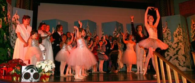 Dancers on the stage bowing after a performance of the nutcracker