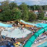 An overview of part of the enchanted forest water safari waterpark full of guests relaxing and playing on the attractions