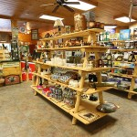 An old forge shop with wooden shelves full of trinkets