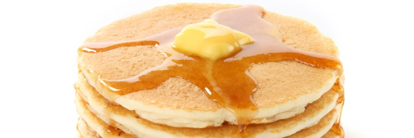 a pancake stack with butter and syrup on top
